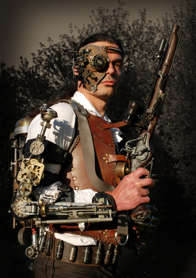 what is Steampunk:steampunk-outfit-with-leather-vest-heavy-gun-vambrace-backpack-time-machine-mask-and-victorian-clothes